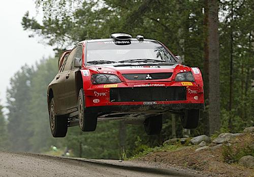 Mitsubishi modelos autos vehiculos de competición rally dakar