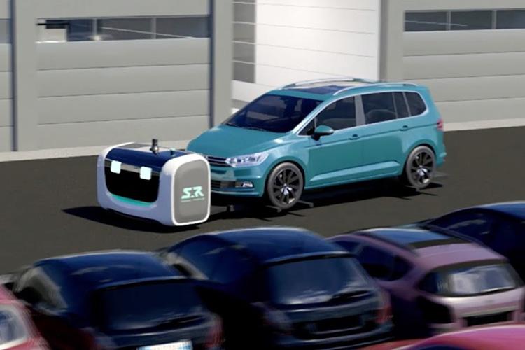 robot Stan estacionando auto
